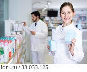 pharmacist who is standing with medicine. Стоковое фото, фотограф Яков Филимонов / Фотобанк Лори