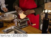 Купить «African chef cooking», фото № 33033593, снято 16 сентября 2019 г. (c) Wavebreak Media / Фотобанк Лори