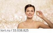 Купить «beautiful young woman with gold facial mask», фото № 33038825, снято 30 ноября 2019 г. (c) Syda Productions / Фотобанк Лори