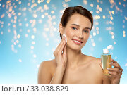Купить «young woman with toner or cleanser and cotton pad», фото № 33038829, снято 30 ноября 2019 г. (c) Syda Productions / Фотобанк Лори