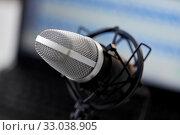 Купить «close up of microphone at recording studio», фото № 33038905, снято 17 мая 2019 г. (c) Syda Productions / Фотобанк Лори