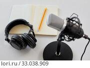 Купить «headphones, microphone and notebook with pencil», фото № 33038909, снято 17 мая 2019 г. (c) Syda Productions / Фотобанк Лори