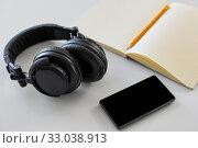 Купить «headphones, smartphone and notebook with pencil», фото № 33038913, снято 17 мая 2019 г. (c) Syda Productions / Фотобанк Лори