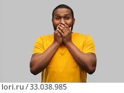Купить «scared african american man covering his mouth», фото № 33038985, снято 15 декабря 2019 г. (c) Syda Productions / Фотобанк Лори