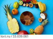 Купить «wooden bowl and different exotic fruits on blue», фото № 33039081, снято 16 ноября 2018 г. (c) Syda Productions / Фотобанк Лори