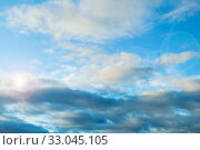Купить «Dramatic blue sky background. Picturesque colorful clouds lit by sunlight. Vast sky landscape panoramic scene», фото № 33045105, снято 16 сентября 2019 г. (c) Зезелина Марина / Фотобанк Лори
