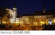 Купить «View of illuminated Masaryk Square at night, Jihlava, Czech Republic», видеоролик № 33045369, снято 14 октября 2019 г. (c) Яков Филимонов / Фотобанк Лори