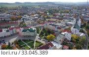 Aerial view of Krnov cityscape overlooking Town hall and St. Martin church on sunny autumn day, Czech Republic. Стоковое видео, видеограф Яков Филимонов / Фотобанк Лори