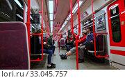 Купить «Interior of modern Prague metro car with traveling people», видеоролик № 33045757, снято 13 октября 2019 г. (c) Яков Филимонов / Фотобанк Лори