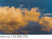 Thunderstorm clouds illuminated by disappearing rays at sunset, thunderclouds floating across sky to change weather. Abstract meteorology background. Стоковое фото, фотограф А. А. Пирагис / Фотобанк Лори
