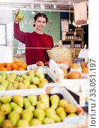 Купить «Girl buying ripe pineapple», фото № 33051197, снято 1 марта 2017 г. (c) Яков Филимонов / Фотобанк Лори