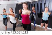 Купить «Females exercising during yoga class», фото № 33051213, снято 29 января 2018 г. (c) Яков Филимонов / Фотобанк Лори