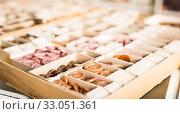 Купить «Buttons in carton on needlework store showcase», фото № 33051361, снято 18 октября 2019 г. (c) Яков Филимонов / Фотобанк Лори