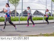 Купить «Russia, Samara, May 2019: a group of young beautiful sports people run around the new stadium at a city event, race.», фото № 33051801, снято 19 мая 2019 г. (c) Акиньшин Владимир / Фотобанк Лори