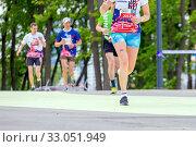 Купить «Russia, Samara, May 2019: legs of a running athlete for a long distance on asphalt.», фото № 33051949, снято 19 мая 2019 г. (c) Акиньшин Владимир / Фотобанк Лори