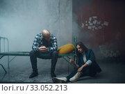 Купить «Maniac kidnapper and victim handcuffed to the bed», фото № 33052213, снято 13 ноября 2019 г. (c) Tryapitsyn Sergiy / Фотобанк Лори