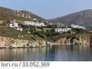 View of the village of Gavrio (Andros Island, Cyclades, Greece) on the coastline (2019 год). Стоковое фото, фотограф Татьяна Ляпи / Фотобанк Лори