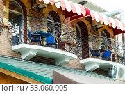 Купить «A cosy café on the balcony. Kerch, Crimea», фото № 33060905, снято 26 июня 2019 г. (c) Владимир Арсентьев / Фотобанк Лори