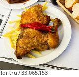 Купить «Baked with red paprika chicken at plate with french fries», фото № 33065153, снято 4 апреля 2020 г. (c) Яков Филимонов / Фотобанк Лори