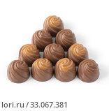 Купить «milk chocolate candies on a light background», фото № 33067381, снято 9 января 2020 г. (c) Володина Ольга / Фотобанк Лори