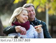 Купить «Mature loving couple in spring park», фото № 33067869, снято 19 февраля 2020 г. (c) Яков Филимонов / Фотобанк Лори