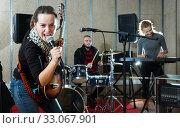 Купить «Jolly girl guitar player and singer with band», фото № 33067901, снято 26 октября 2018 г. (c) Яков Филимонов / Фотобанк Лори