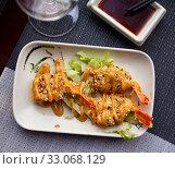 Купить «Roasted shrimps in tempura batter and sesame», фото № 33068129, снято 20 февраля 2020 г. (c) Яков Филимонов / Фотобанк Лори