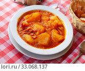 Купить «Stewed squid with potatoes», фото № 33068137, снято 20 февраля 2020 г. (c) Яков Филимонов / Фотобанк Лори