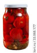 Купить «Tomatoes marinated in jars on a wooden table», фото № 33068177, снято 26 февраля 2020 г. (c) Яков Филимонов / Фотобанк Лори