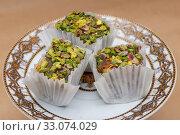 Купить «Three slices of fruit and nut pistachio lokum on a saucer», фото № 33074029, снято 21 января 2020 г. (c) ok_fotoday / Фотобанк Лори