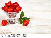 Купить «Ripe strawberries on a wooden table.», фото № 33074521, снято 23 июня 2019 г. (c) Елена Блохина / Фотобанк Лори