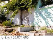 Купить «Entrance doors in the wall of the old house. Kerch, Crimea», фото № 33074605, снято 30 июня 2019 г. (c) Владимир Арсентьев / Фотобанк Лори