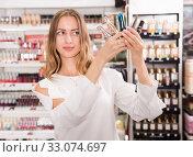 Купить «Girl holding mascara for eyes in makeup store», фото № 33074697, снято 19 октября 2019 г. (c) Яков Филимонов / Фотобанк Лори