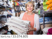 Купить «customer female choosing cotton tablecloths in the textile store», фото № 33074805, снято 29 ноября 2017 г. (c) Яков Филимонов / Фотобанк Лори