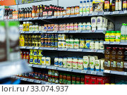 Купить «Assortment of sauces on showcase in supermarket», фото № 33074937, снято 7 ноября 2019 г. (c) Яков Филимонов / Фотобанк Лори
