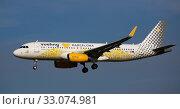 Купить «Vueling Airbus approaching to runway at El Prat Airport», фото № 33074981, снято 26 января 2020 г. (c) Яков Филимонов / Фотобанк Лори