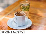 Купить «Traditional turkish coffee. Street cafe. Istanbul, selective focus. Избирательный, мягкий фокус», фото № 33075021, снято 29 июня 2013 г. (c) Gagara / Фотобанк Лори