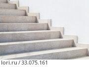 Купить «Empty stone stairway near white wall, abstract photo», фото № 33075161, снято 15 января 2020 г. (c) EugeneSergeev / Фотобанк Лори