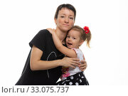 Mom and daughter hugged each other, isolated on a white background. Стоковое фото, фотограф Иванов Алексей / Фотобанк Лори