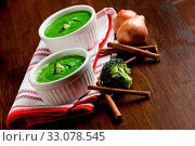 Купить «Photo of delicious creamy smooth broccoli soup on wooden», фото № 33078545, снято 13 июля 2020 г. (c) easy Fotostock / Фотобанк Лори
