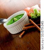 Купить «Photo of delicious creamy smooth broccoli soup on wooden», фото № 33079045, снято 13 июля 2020 г. (c) easy Fotostock / Фотобанк Лори