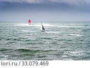 Купить «Sailing boat in the sea with bad weather. Boat sailing in the upcoming storm near lighthouse.», фото № 33079469, снято 29 июля 2018 г. (c) easy Fotostock / Фотобанк Лори