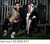 Купить «Two people in evening village scenery flirting», фото № 33093917, снято 15 июля 2020 г. (c) PantherMedia / Фотобанк Лори