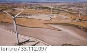 Купить «Aerial view of wind power station installed on blue sky background», видеоролик № 33112097, снято 28 марта 2020 г. (c) Яков Филимонов / Фотобанк Лори