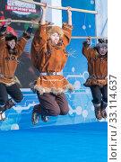 Aborigine female dancer jumping in national clothes of indigenous people Kamchatka Peninsula. Koryak National Dance Ensemble Mengo (2019 год). Редакционное фото, фотограф А. А. Пирагис / Фотобанк Лори