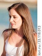 Купить «attractive smiling young brunette woman in the sunshine outdoor», фото № 33118013, снято 29 марта 2020 г. (c) PantherMedia / Фотобанк Лори