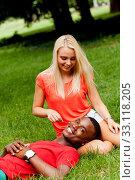 Купить «young enamored multicultural couple in a meadow», фото № 33118205, снято 25 мая 2020 г. (c) PantherMedia / Фотобанк Лори