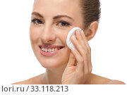 Купить «young attractive woman with well-kept skin and cotton pad», фото № 33118213, снято 25 мая 2020 г. (c) PantherMedia / Фотобанк Лори