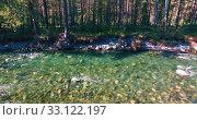 Купить «Low altitude flight over fresh fast mountain river with rocks at sunny summer morning.», видеоролик № 33122197, снято 9 апреля 2019 г. (c) Александр Маркин / Фотобанк Лори