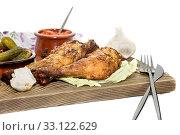 Купить «Fried chicken legs on a cutting board close-up», фото № 33122629, снято 5 февраля 2020 г. (c) Татьяна Ляпи / Фотобанк Лори